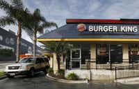 Burger King Worldwide yesterday reported it earned an adjusted profit of 23 cents per share two cents higher than analysts expected.