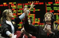 Karin Bratta, left, and Patricia Dannevik make their offer in the Eurodollar options trading pit Wednesday, Jan. 30, 2008, at the Chicago Mercantile Exchange.