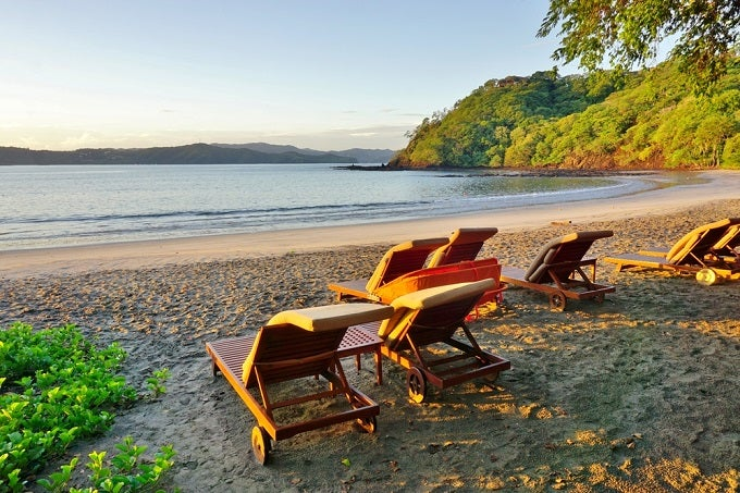 https://i.investopedia.com/content/slideshow/8_countries_where_2/shutterstock_348924287_retire_beach_costa_rica.jpg